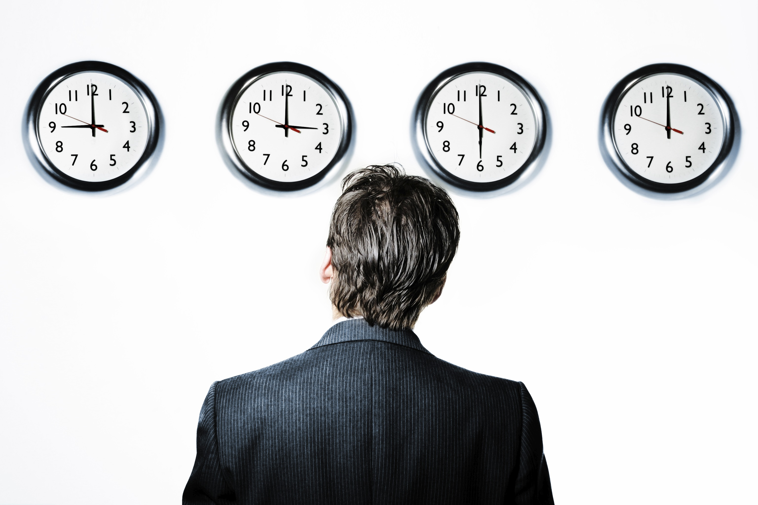 businessman-looking-at-clocks-253378